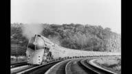 Steam engine passenger train quickly speeding by camera Steam engine passenger train on January 01 1930
