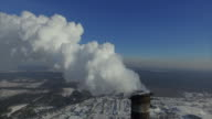 Steam from the 270-meter chimney bright frosty winter day. Rise above the pipe with the lowering of the camera