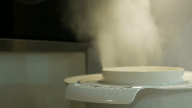 Steam lifts up over from cooking pan