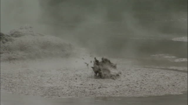 Steam rises from a hot boiling pool of mud. Available in HD.