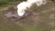 Steam rises from fumaroles of sulfur near the runway on Iwo Jima Island, Japan.