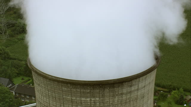 AERIAL Steam rising from cooling tower at power station near Poppinghausen, North Rhine-Westphalia, Germany