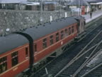 WS Steam train leaving station, life in town including wedding and playing on beach / Towyn, Conwy, Wales