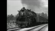 Steam train passing on tracks Transportation traveling passenger car