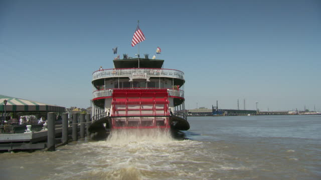 WS Steamboat paddle churning waters / New Orleans, Louisiana, United States