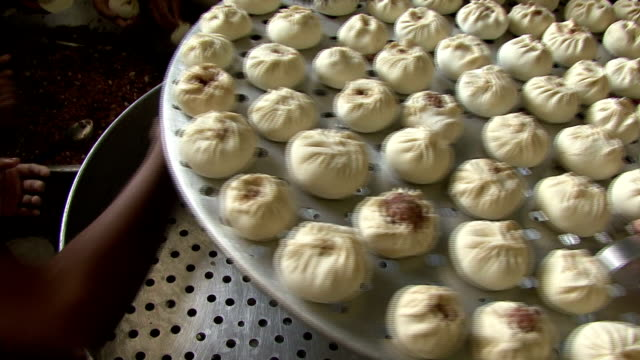 Steamed buns with stuffing meat and kitchenware