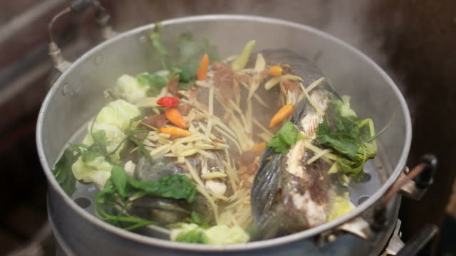 Steamed fish with vegetables and herbs.