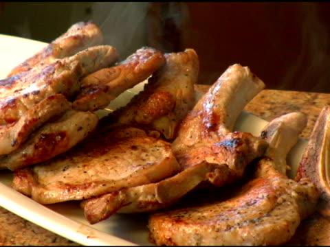 Steaming Pork Chops on plate.