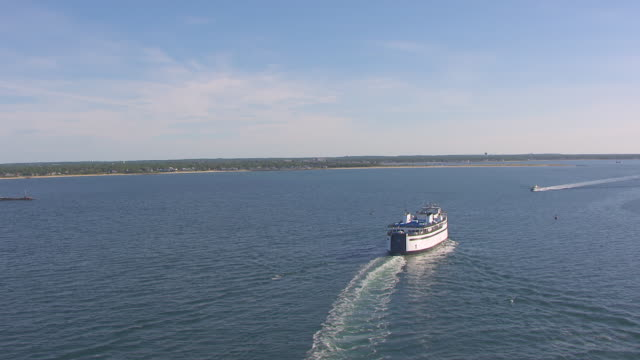 WS AERIAL POV Steamship Authority moving on sea, town in background / Hyannis, Massachusetts, United States