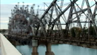 MS Steel bridge collapsing into river  in controlled implosion with  explosives / Bismarck, North Dakota, USA