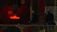 Tata Steel set to cut 1200 jobs / government summit ENGLAND South Yorkshire Sheffield Stocksbridge Tata Steel INT Close shot of molten steel in...