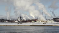 LS Steel mills spewing smoke on a river / Sault Sainte Marie, Canada