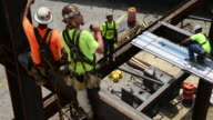 Steelworkers construct a 12story commercial building in Columbus Ohio