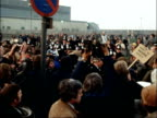 Steelworkers picket steel works in Sheerness over pay dispute ENGLAND Kent Sheerness Massed crowd of pickets along chanting one waves camera off SOT...