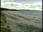 SHARON SCOTLAND Mull of Kintyre Saddell Beach Deserted beach GV Deserted beach and shoreline PAN MS SIDE Photographers waiting LMS House PAN beach