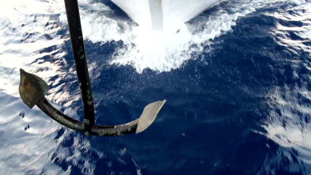 Stem of yacht in motion, surface sea water