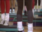 Step aerobics class people wearing leg warmers leotards and other eighties sportswear