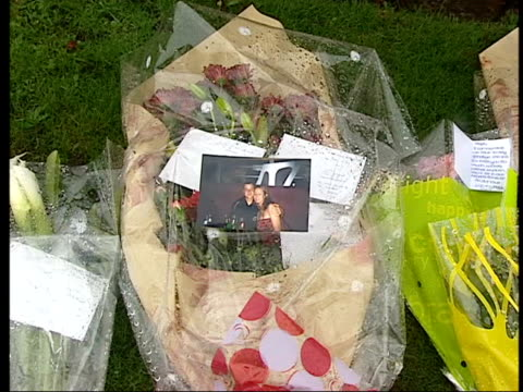 Boyfriend appeal ITN ENGLAND West Yorkshire Wakefield Roadside with moving cars Floral tributes James Garland press conference SOT **flash...