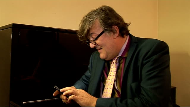 Stephen Fry interview on his new autobiography ENGLAND INT Stephen Fry using iPhone and chatting to reporter SOT Stephen Fry interview SOT On who...