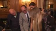 Stephen Jones Yasmin Le Bon and Gianluca Longo Dorchester Collection Fashion prize Judges examine Hermione de Paula's designs at the Dorchester...