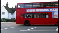 Day 2 ENGLAND London Eltham EXT Red doubledecker bus driving away from bus stop where Stephen Lawrence was fatally stabbed on 2241993
