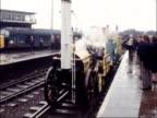 Stephenson's Rocket arrives at St Pancras Station ENGLAND London St Pancras Station Engine into station BV TILT smoke from stack back to men on...
