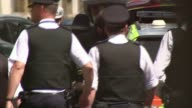 Steve White announces he will step down as Police Federation Chair T20071713 / TX Liverpool Back view police officers in street
