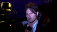 Steve Zahn talking to reporter on the red carpet at the Museum of Modern Art