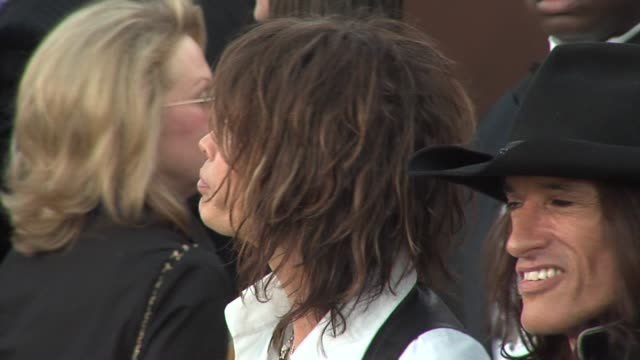 Steven Tyler and Joe Perry of Aerosmith at the 2006 Grammy Awards arrivals at the Staples Center in Los Angeles California on February 8 2006