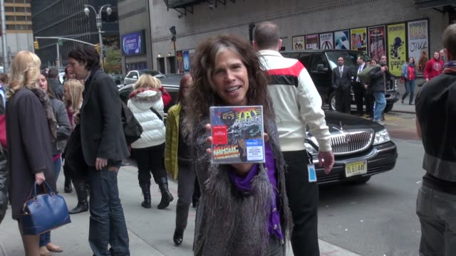 Steven Tyler of Aerosmith poses with the new CD outside of the Late Show in New York NY on 11/01/12