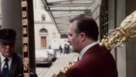 1985 MONTAGE A steward places a ceremonial sword and scepter into a car / London, England†