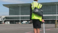 WS Stewardess walking in front of airport terminal / Luxembourg Airport, Findel, Luxembourg, Luxembourg