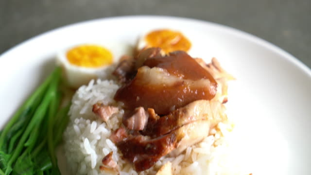 Stewed pork leg with egg and vegetable on rice
