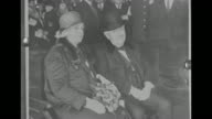 Still 2shot inventor Thomas Edison with his wife Mina Miller Edison he wears a top hat and she wears a fur stole as they sit in a carriage / still...