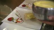 Still shot of desserts being plated at Italian restaurant