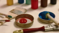 DIY: Stirring red and blue colors on craft table