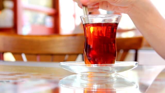 Stirring Tea in a clear glass