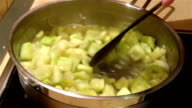 Stirring zucchini and onion