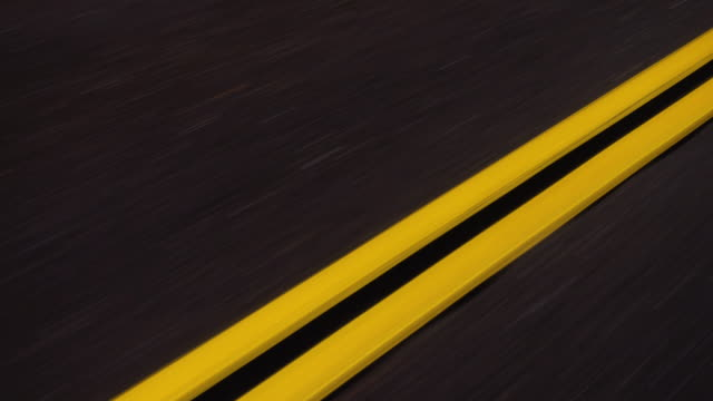 Stock footage 4k Yellow Lines on a Roadway Driving POV