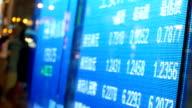 stock or currency exchange board on street of Hongkong