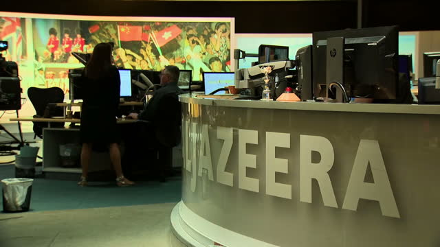 Stock shots of Al Jazeera Head Quarters showing television newsroom and staff at work in Doha on July 3rd 2017