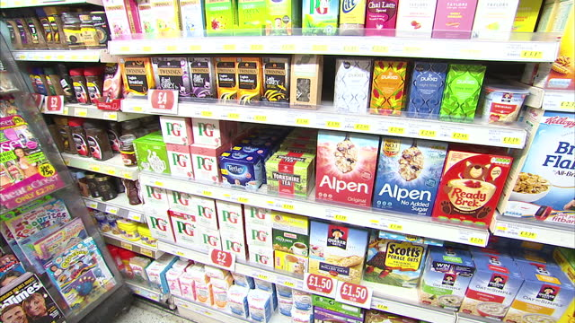 Stock shots of breakfast cereals on display at grocery store including AllBran Organic Porridge Kellogg's Bran Flakes Crunchy Nut Coco Pops Special K