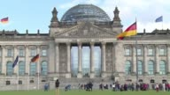 Stock shots of the modern building of German Chancellery and the older parliament building the Reichstag where newly elected MPs will sit after the...