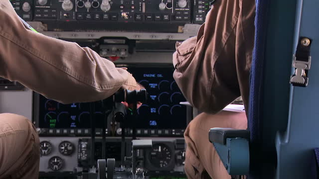 Stock shots Qatari Air Force personnell going through checks outside and inside military plane including shots of pilots inside cockpit at Al Udeid...