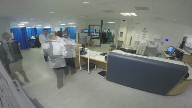 Stock shots time lapse as doctors and nurses walk around Accident and Emergency station at King's Mill Hospital Nottingham