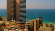 Stock Video Footage of Mediterranean sailboats and Tel Aviv shot in Israel at 4k with Red.