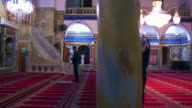 Stock Video Footage of praying muslims at a mosque filmed in Israel at 4k with Red.