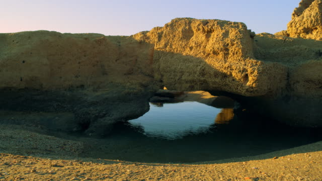 Stock Video Footage panorama of a coastal rock arch at Dor Beach shot in Israel at 4k with Red.