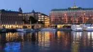 Stockholm Sweden skyline and Grand Hotel at twilight on water night exposure city night