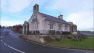 Stone building, pub or schoolhouse onhill, Northern Ireland